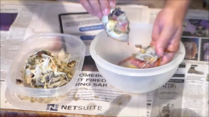 taking off the top shell of blue crab